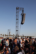 Crowds gather near the speakers at the Outdoor Stage at the 2010 Coachella Music Festival in Indio, CA on Friday, April 16, 2010.