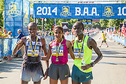 Boston Athletic Association 10K road race: repeat winner Mamitu Daska, Stephen Sambu with Geoffrey Mutai