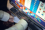 Woman collecting her money from a slot machine