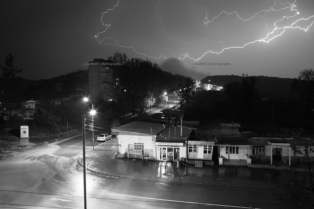 "A though thunderstorm at night above Shushi center. This image is part of the photoproject ""The Twentieth Spring"", a portrait of caucasian town Shushi 20 years after its so called ""Liberation"" by armenian fighters. In its more than two centuries old history Shushi was ruled by different powers like armeniens, persians, russian or aseris. In 1991 a fierce battle for Karabakhs independence from Azerbaijan began. During the breakdown of Sowjet Union armenians didn´t want to stay within the Republic of Azerbaijan anymore. 1992 armenians manage to takeover ""ancient armenian Shushi"" and pushed out remained aseris forces which had operate a rocket base there. Since then Shushi became an ""armenian town"" again. Today, 20 yeras after statement of Karabakhs independence Shushi tries to find it´s opportunities for it´s future. The less populated town is still affected by devastation and ruins by it´s violent history. Life is mostly a daily struggle for the inhabitants to get expenses covered, caused by a lack of jobs and almost no perspective for a sustainable economic development. Shushi depends on donations by diaspora armenians. On the other hand those donations have made it possible to rebuild a cultural centre, recover new asphalt roads and other infrastructure. 20 years after Shushis fall into armenian hands Babies get born and people won´t never be under aseris rule again. The bloody early 1990´s civil war has moved into the trenches of the frontline 20 kilometer away from Shushi where it stuck since 1994. The karabakh conflict is still not solved and could turn to an open war every day. Nonetheless life goes on on the south caucasian rocky tip above mountainious region of Karabakh where Shushi enthrones ever since centuries."