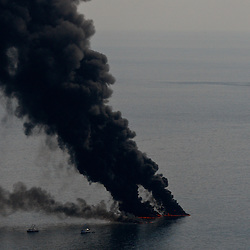 Smoke billows and fire is seen from controlled oil burns near the site of the BP Plc Deep Water Horizon oil spill site in the Gulf of Mexico off the coast of Louisiana, U.S., on Saturday, June 19, 2010. (Mandatory Credit: Derick E. Hingle)