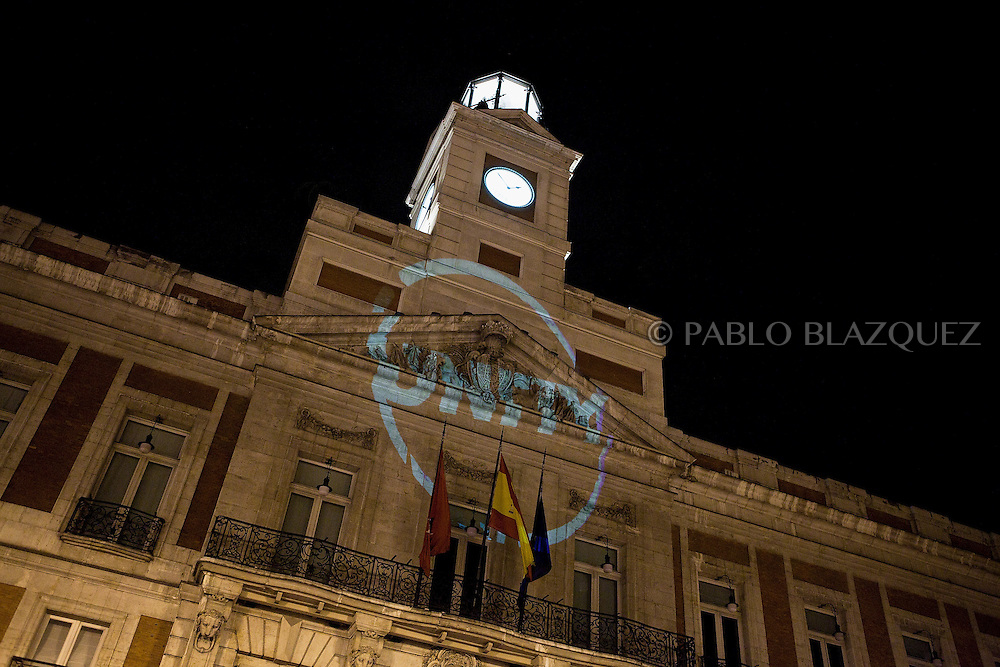Demonstrators make projections that says 'UNITY' over the wall of Presidency of the Community of Madrid at Puerta del Sol Square on May 19, 2011 in Madrid, during protests against Spain's economic crisis and its sky-high jobless rate.Protests over the economic crisis began in Madrid on May 15 and fanned out to city squares nationwide as word spread by Twitter and Facebook among demonstrators known variously as 'the indignant', 'M-15', 'Spanish Revolution' and 'Real Democracy Now'.