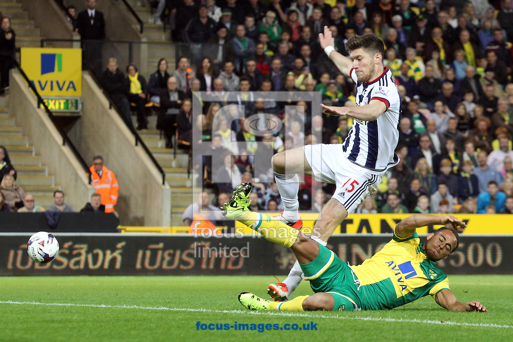 Elliott Bennett of Norwich goes close but is put off by the presence of Sebastien Pocognoli of West Bromwich Albion during the Capital One Cup match at Carrow Road, Norwich<br /> Picture by Paul Chesterton/Focus Images Ltd +44 7904 640267<br /> 23/09/2015