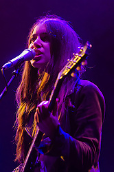 "© Licensed to London News Pictures. 05/12/2012. London, UK.   Danielle Haim of Haim performing live at The O2 Arena supporting Florence and the Machine. Haim Is a ""nu-folk-meets-nineties-R&B"" pop group from Los Angeles, California. The band is composed of sisters, Este, Danielle and Alana Haim.  Photo credit : Richard Isaac/LNP"