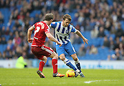 Brighton central midfielder, Dale Stephens (6) takes on Middlesbrough FC midfielder Grant Leadbitter during the Sky Bet Championship match between Brighton and Hove Albion and Middlesbrough at the American Express Community Stadium, Brighton and Hove, England on 19 December 2015.