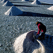 The wife of Celso helps to load the salt that her husband takes.  Salar de Uyuni ( Uyuni salt flat ) . Department  of Potosí  ( Los Lipez).  South West  Bolivia.