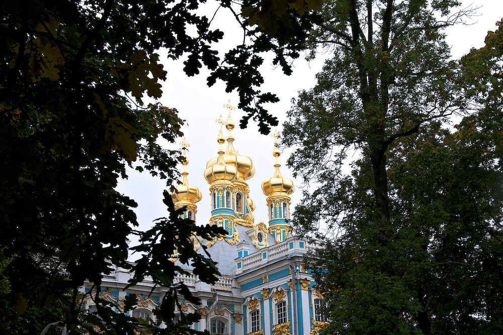 The Catherine Palace is a Rococo palace just southeast of St. Petersburg, Russia in the town of Tsarskoye Selo.  The facade and statues on the roof are said to have been crafted with more than 100 kilograms of gold.