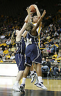 28 NOVEMBER 2007: Iowa center Stacy Schlapkohl (40) puts up a shot over Georgia Tech forward Brigitte Ardossi (35) and Georgia Tech forward Janie Mitchell (21) in the first half of Georgia Tech's 76-57 win over Iowa in the Big Ten/ACC Challenge at Carver-Hawkeye Arena in Iowa City, Iowa on November 28, 2007.