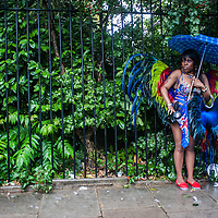 London, UK - 25 August 2014: a reveller protects from the rain during the Notting Hill Carnival in London.