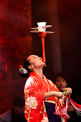 © Licensed to London News Pictures. 29/09/2019. LONDON, UK.  Michiyo Kagami gives a special daikagura performance, a form of Japanese entertainment combining juggling with delicate balancing techniques, at the 11th annual Japan Matsuri takes place in Trafalgar Square, bringing a taste of Japanese culture to the capital.  Photo credit: Stephen Chung/LNP