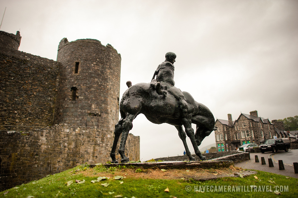 The statue of the Two Kings next to Harlech Castle in northwestern Wales. Sculpted by Ivor Roberts-Jones and unveiled in 1984, the sculpture depicts the Mabinogion story of Branwen, a lament of the folly and carnage of war. In the sculpture, the figure of Bendigeidfran, bearing the body of his nephew Gwern, symbolises the sorrowful burden that love can be. Harlech Castle in Harlech, Gwynedd, on the northwest coast of Wales next to the Irish Sea, was built by Edward I in the closing decades of the 13th century as one of several castles designed to consolidate his conquest of Wales.