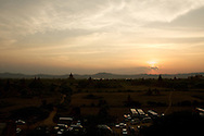 Tour buses at sunset at Shwe-san-daw Paya, Bagan