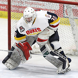 WELLINGTON, ON - FEBRUARY 9: Logan Bateman #30 of the Wellington Dukes signals the end of the penalty during the third period on February 9, 2019 at Wellington and District Community Centre in Wellington, Ontario, Canada.<br /> (Photo by Tim Bates / OJHL Images)