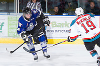 KELOWNA, CANADA - JANUARY 2:  Jordan Fransoo #4 of the Victoria Royals is checked by Dylen McKinlay #19 of the Kelowna Rockets at the Kelowna Rockets on January 2, 2013 at Prospera Place in Kelowna, British Columbia, Canada (Photo by Marissa Baecker/Shoot the Breeze) *** Local Caption ***