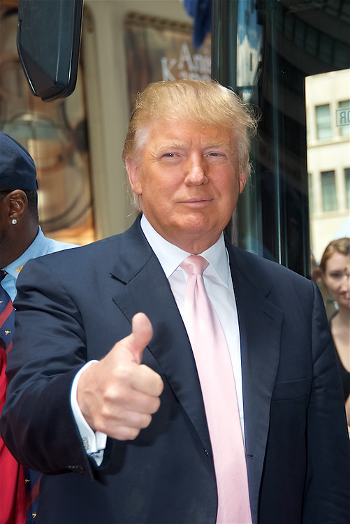 """Donald Trump honored in Gray Line New York's """"Ride of Fame"""" campaign with a bus dedication outside Trump Tower."""