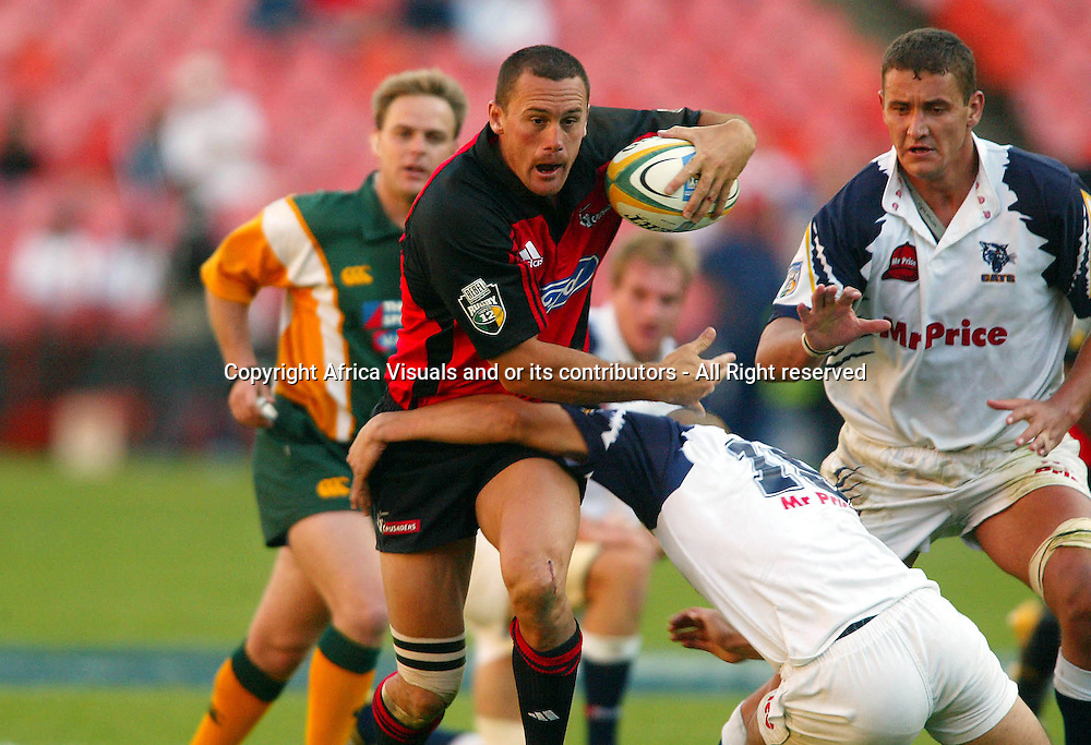 17 April, 2004. Rugby Union Super 12. Ellis Park, Johannesburg, South Africa. Cats vs Crusaders. Caleb Ralph gets tackled by Conrad Jantjes. The Crusaders won the match 39-37.<br /> Pic: Photosport