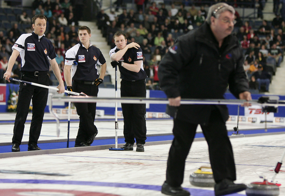 Scottish skip Tom Brewster reacts with surprise after a measurement by officials awarding Norway 1 point not two during their semi-final at the Ford World Men's Curling Championships in Regina, Saskatchewan, April 9, 2011.<br /> AFP PHOTO/Geoff Robins