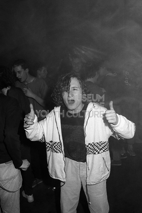 Man dancing in a Rave with thumbs up, High Wycombe, UK, 1980s.