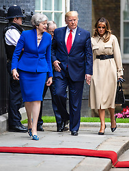 © Licensed to London News Pictures. 04/06/2019. London, UK. Prime Minister Theresa May (2-R) and her husband Philip May (2-L) greet President of the United States Donald Trump (3-L) and Melania Trumo (R) on Downing Street. President Trump is in the UK for a three-day State Visit. Photo credit: Rob Pinney/LNP