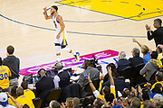 Golden State Warriors guard Stephen Curry (30) celebrates a three pointer against the Utah Jazz during Game 2 of the Western Conference Semifinals at Oracle Arena in Oakland, Calif., on May 4, 2017. (Stan Olszewski/Special to S.F. Examiner)