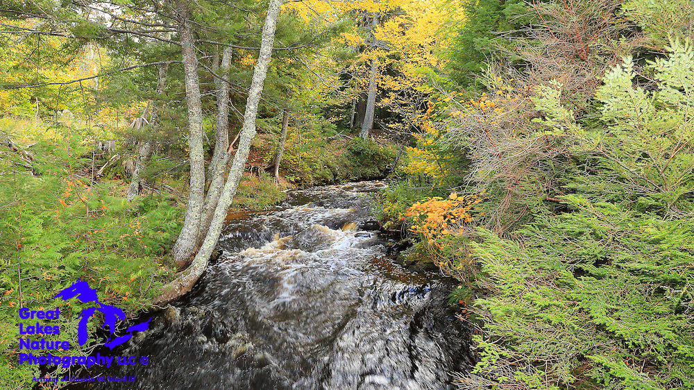 The Hurricane River emerges from dense forest and makes its final rush toward Lake Superior.