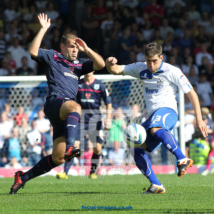 Picture by Michael Sedgwick/Focus Images Ltd +44 7900 363072.08/09/2012.Mark Carrington of Bury and John Welsh of Preston North End in action during the npower League 1 match at Gigg Lane, Bury.