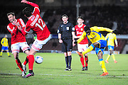 Arthur Gnahoua of Kidderminster Harriers gets a shot away during the Vanarama National League match between Wrexham AFC and Kidderminster Harriers at the Glyndŵr University Racecourse Stadium, Wrexham, United Kingdom on 23 February 2016. Photo by Mike Sheridan.