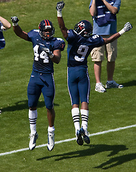 Virginia running back Raynard Horne (44) celebrates with Virginia Javaris Brown (9) after Horne scored a touchdown.  The Virginia Cavaliers football team played the annual spring football scrimmage at Scott Stadium on the Grounds of the University of Virginia in Charlottesville, VA on April 18, 2009.  (Special to the Daily Progress / Jason O. Watson)
