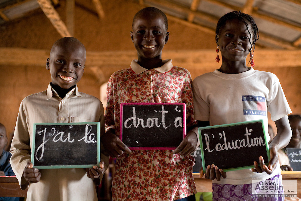 "Children hold chalk boards on which are written words forming the sentence ""I have the right to education"" at the Kabiline I Primary school in the village of Kabiline, Senegal on Wednesday June 13, 2007..."