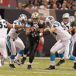 2008 December, 28: New Orleans Saints running back Deuce McAllister (26) runs through the arm tackles of Carolina Panthers defenders during a week 17 game between NFC South divisional rivals the Carolina Panthers and the New Orleans Saints at the Louisiana Superdome in New Orleans, LA.