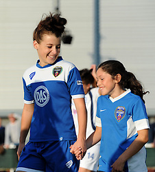 Angharad James of Bristol Academy Women and her mascot walk on to the pitch at Stoke Gifford Stadium - Mandatory by-line: Paul Knight/JMP - Mobile: 07966 386802 - 05/09/2015 -  FOOTBALL - Stoke Gifford Stadium - Bristol, England -  Bristol Academy Women v Birmingham City Ladies FC - FA Women's Super League