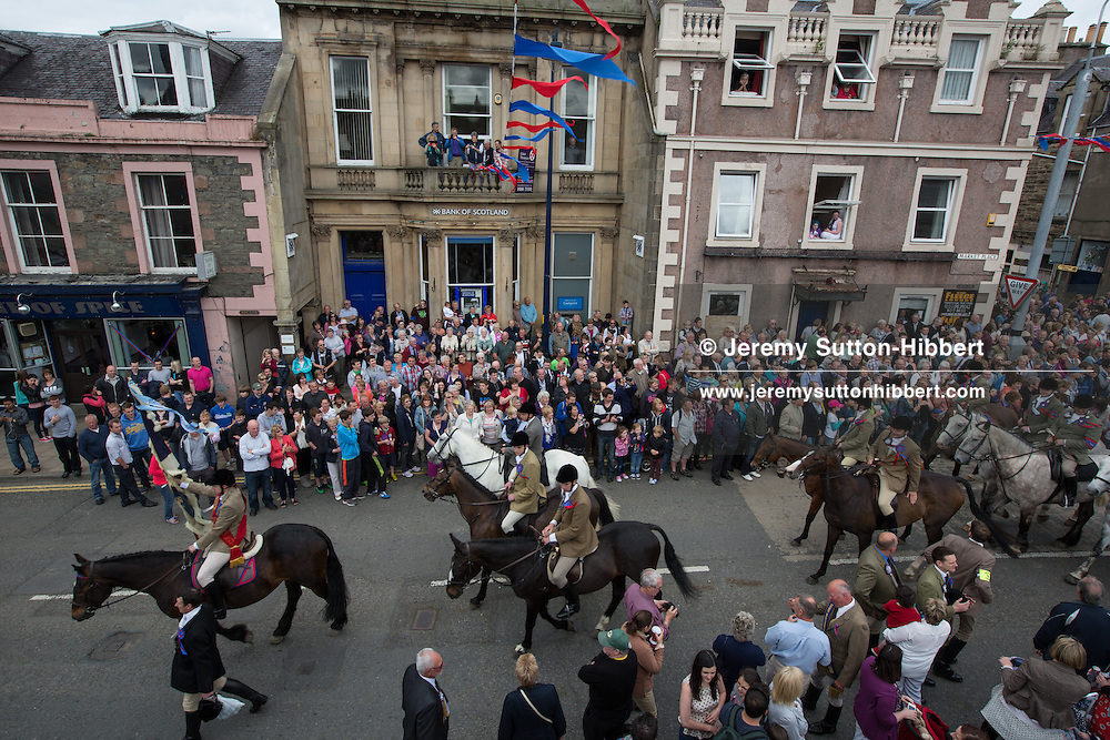 The Casting of the Colours ceremony, where the town's associations flags are waved in spectacular fashion in front of large crowds, led by Royal Burgh Standard Bearer Martin Rodgerson and his Burleymen, during the Common Riding festivities in Selkirk, in Selkirk, Scotland, Friday 14th June 2013. <br /> N55&deg;32.822'<br /> W2&deg;50.517'