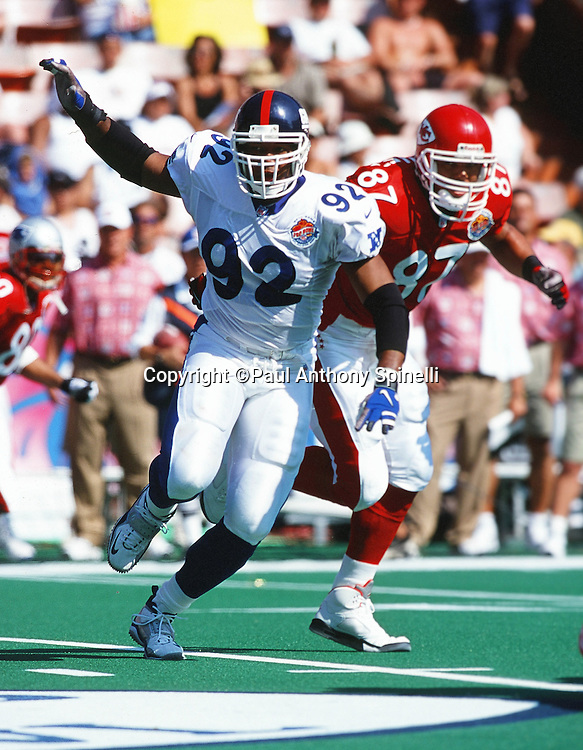 NFC New York Giants defensive end Michael Strahan (92) chases the action during the NFL Pro Bowl Football game against the AFC on Feb. 6, 2000 in Honolulu. The NFC won the game 51-31. (©Paul Anthony Spinelli)