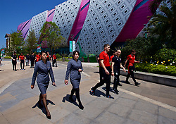 NANNING, CHINA - Tuesday, March 20, 2018: Security accompany Wales' Sam Vokes during a team walk at the Wanda Realm Resort ahead of the 2018 Gree China Cup International Football Championship. (Pic by David Rawcliffe/Propaganda)