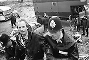 A46 man getting evicted, Solsbury Hill, Somerset, UK, 1994.