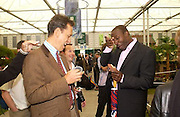 Richard E. Grant and Linford Christie, Chelsea Flower Show. 19 May 2003. © Copyright Photograph by Dafydd Jones 66 Stockwell Park Rd. London SW9 0DA Tel 020 7733 0108 www.dafjones.com