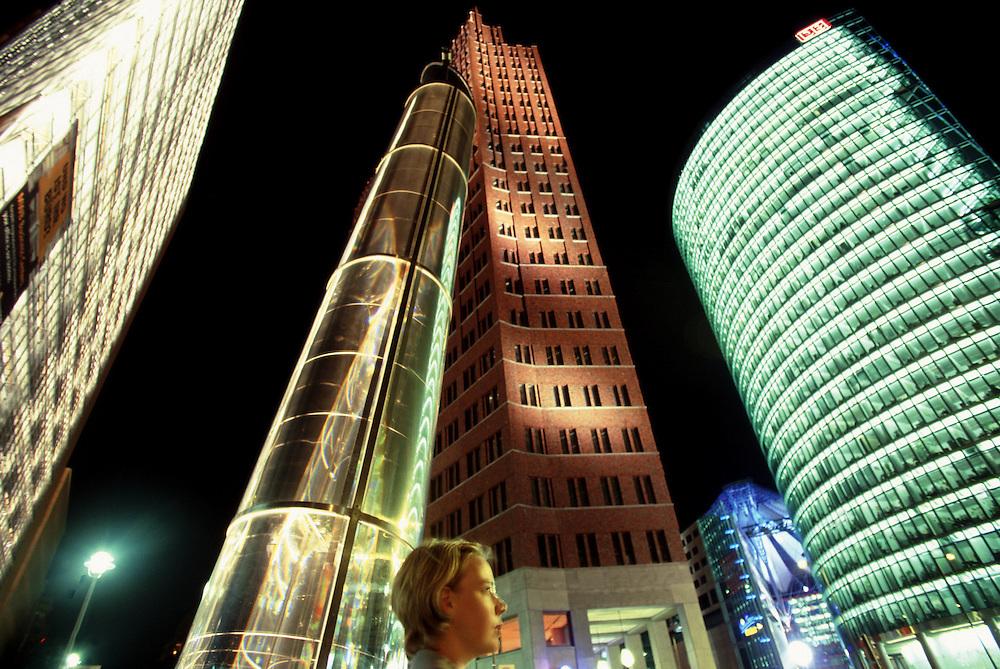 Business woman's profile in Potsdamer Platz, Berlin, Germany at night