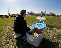 Austin Johnson fires his rocket to the sky at Opechee Park on Monday morning along with fellow students from Mrs. Gilbert's, and Mr. Konchak's CCR Physical Science class at Laconia High School.  (Karen Bobotas/for the Laconia Daily Sun)