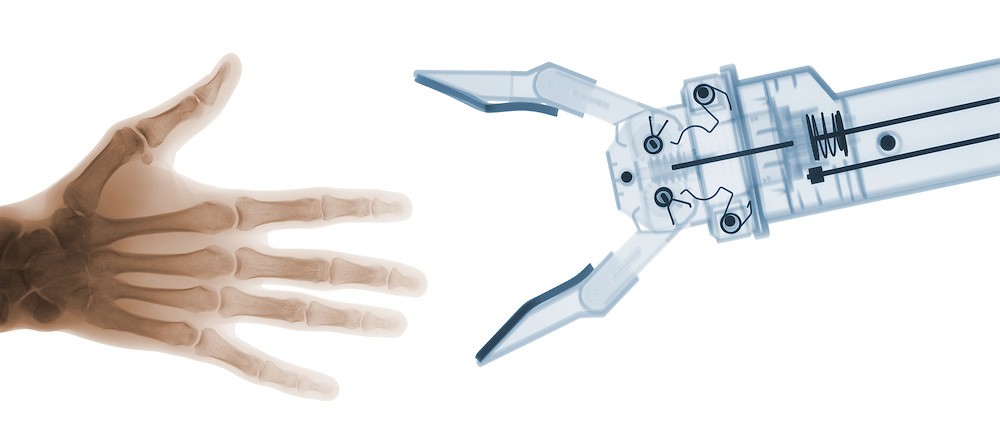 X-ray image of human and robot hands (color on white) by Jim Wehtje, specialist in x-ray art and design images.
