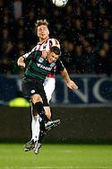 26-01-2016 VOETBAL:WILLEM II-FC GRONINGEN:TILBURG<br /> <br /> Jordens Peters van Willem II in duel met  Bryan Linssen van FC Groningen <br /> <br /> Foto: Geert van Erven