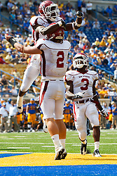 September 24, 2011; San Jose, CA, USA;  New Mexico State Aggies quarterback Matt Christian (2) is congratulated by wide receiver Taveon Rogers (1) after scoring a touchdown against the San Jose State Spartans during the third quarter at Spartan Stadium. San Jose State defeated New Mexico State 34-24.
