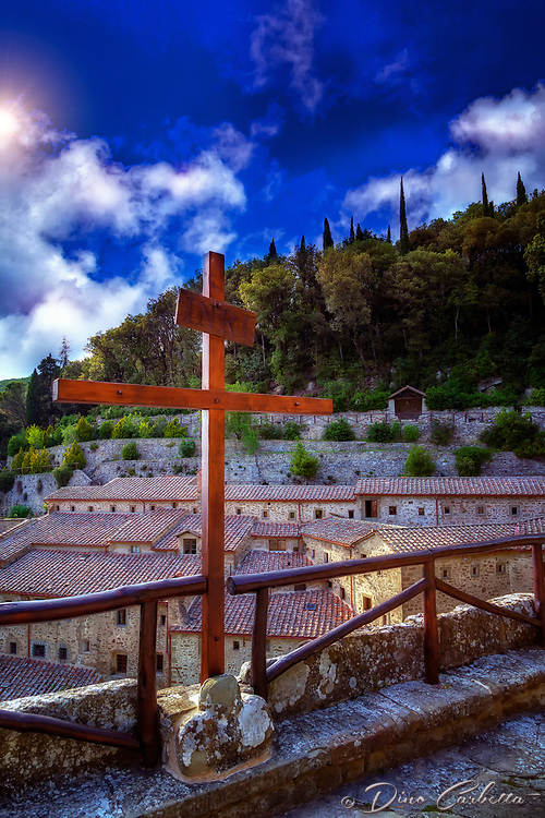 """The evening sun shines on the cross at the Convent of Celle Cortona""...<br />