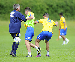 Bristol Rovers players struggle to avoid Bristol Rovers Manager, John Ward - Photo mandatory by-line: Joe Meredith/JMP - Tel: Mobile: 07966 386802 24/06/2013 - SPORT - FOOTBALL - Bristol -  Bristol Rovers - Pre Season Training - Npower League Two