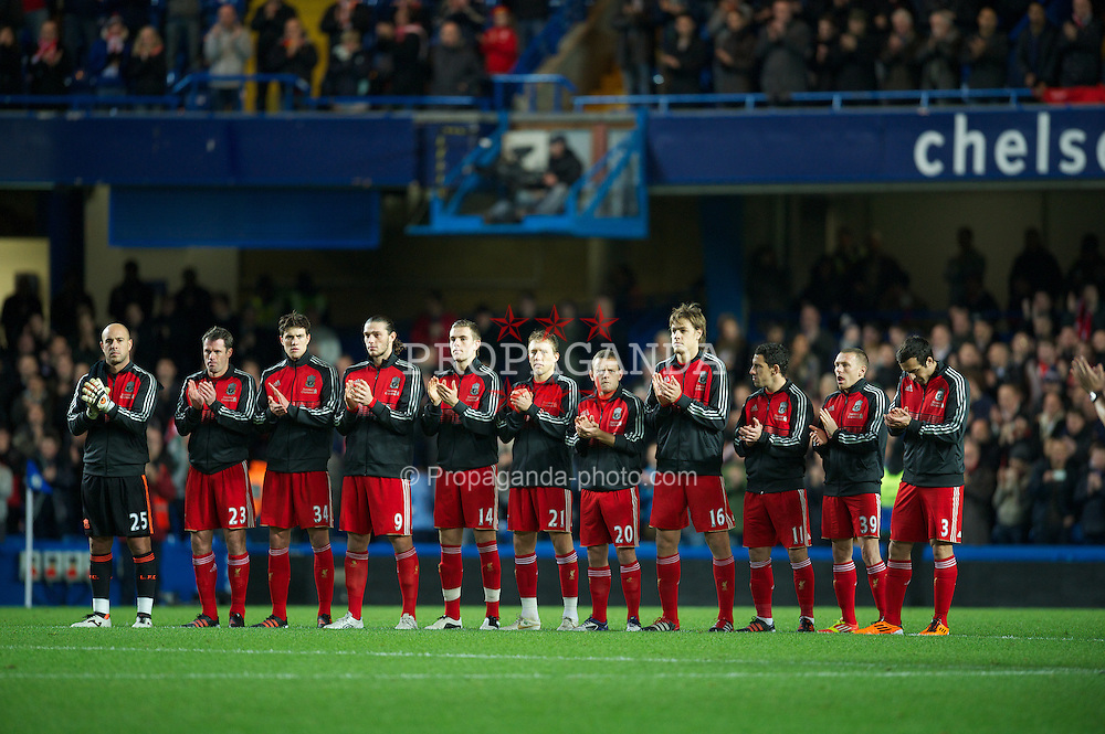 LONDON, ENGLAND - Tuesday, November 29, 2011: Liverpool's players applaud as they remember Wales manager Gary Speed, who died earlier this week, before the Football League Cup Quarter-Final match at Stamford Bridge. (Pic by David Rawcliffe/Propaganda)