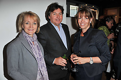 Left to right, GAIL TAYLOR and ANDREW & KAREN HOWES at a party to celebrate the publication of 'Garden' by Randle Siddeley held at Linley, 60 Pimlico Road, London on 24th May 2011.