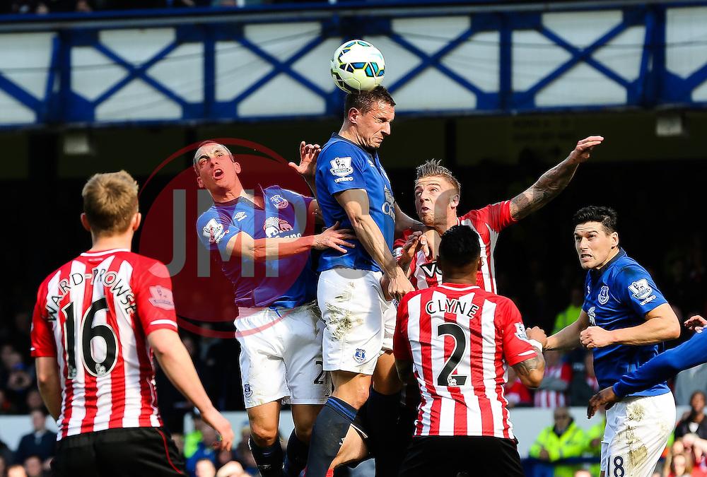 Everton's Phil Jagielka climbs to win a header - Photo mandatory by-line: Matt McNulty/JMP - Mobile: 07966 386802 - 04/04/2015 - SPORT - Football - Liverpool - Goodison Park - Everton v Southampton - Barclays Premier League
