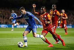 Chelsea Midfielder Eden Hazard (BEL) is tackled by Galatasaray Midfielder Aurelien Chedjou (CMR) - Photo mandatory by-line: Rogan Thomson/JMP - 18/03/2014 - SPORT - FOOTBALL - Stamford Bridge, London - Chelsea v Galatasaray - UEFA Champions League Round of 16 Second leg.