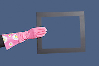 Hand in rubber gloves holding frame over blue background