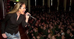 Kelly Llorrenna plays two live sets for 1420 Pupils at The City School, Stradbrooke In Sheffield.<br /> Pupil Fiona Trigg  entered a competition in the Local Sheffield Star Evening paper which brought Kelly to the school<br /> <br /> 12 December 2002<br /> Image Copyright Paul David Drabble<br /> www.pauldaviddrabble.co.uk