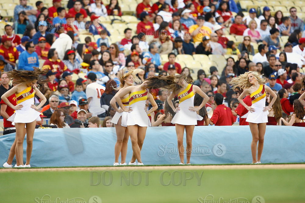 13 March 2011: NCAA Pac-10 college UCLA-USC sports rivalry baseball teams met in a non-conference game at Dodger Stadium as part of the Dodgertown Classic.  USC Trojans defeated the UCLA Bruins 2-0 during an afternoon weekend game inside the MLB stadium.  Cheerleaders on the field cherring to the fans during the game.
